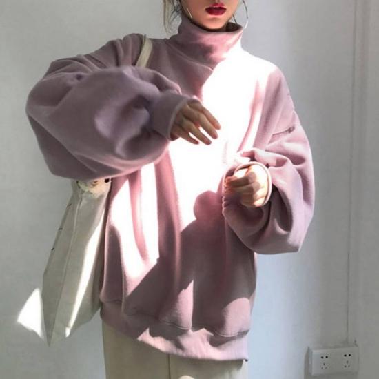スウェットを着た女性